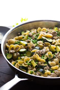 An easy one pan turkey pasta recipe with zucchini, peas, lemon and parmesan cheese. An easy and healthy weeknight dinner recipe.