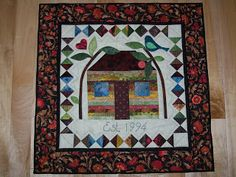 Dorothy and the Land of Quilts: House wallhanging finished. Great central block for signature quilt