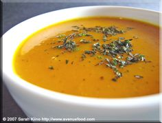 JAMAICAN-SPICEDKABOCHA SOUP    1 Kabocha pumpkin (3-4 pounds)  1 tablespoon butter  1 large onion, chopped  2 teaspoons chopped fresh thyme  1 cup coconut milk  2-3 cups low-sodium chicken broth  1-2firm, whole, unbroken Scotch bonnet chiles (or habaneros)