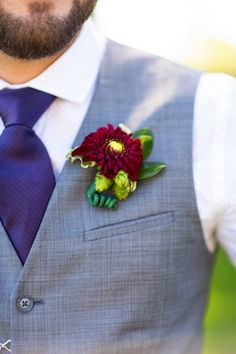 real weddings dahlia boutonniere pinned onto vest photo