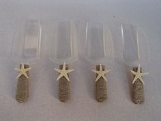 Set of 4 Beach Candy Scoops wrapped in burlap ribbon topped with a tan starfish. Great addition to your candy buffet for weddings, parties,