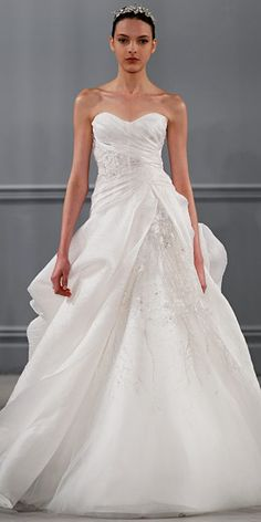 Monique Lhuillier Spring 2014: Silk white organza strapless draped bodice with asymmetric floral embroidered horsehair peplum and full skirt.