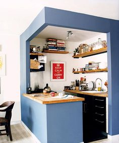Use Paint to Outline Your Small Kitchen -- This otherwise cramped, semi-enclosed kitchen space gets a life of its own with the help of a careful and precise paint job. It now looks like a little cozy oasis, set apart from the rest of the home.