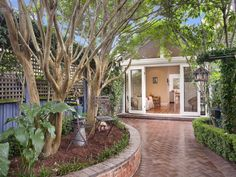 Landscaped garden design using pavers with retaining wall & hedging - Gardens photo 663006