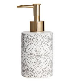 White/patterned. Soap dispenser in stoneware with a printed pattern and a plastic pump. Diameter 3 1/4 in., height 6 1/2 in.