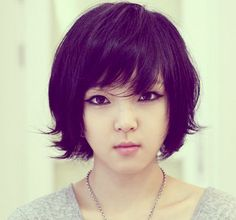 Trendy Asian women hairstyle with layers and long bangs