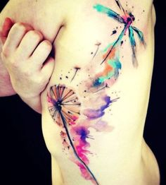Colorful tattoo dandelion and dragonfly