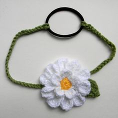 15 petal Daisy Headband with hairband attached for stretchiness.