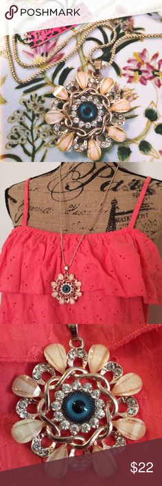 """Betsey Johnson Eyeball Necklace NWT! Never worn. Brand new. Beautiful blue eye within a flower design and diamond accents. Absolutely gorgeous! Long hanging necklace. Length: 16"""". Non-adjustable chain. Silver with a slight rose gold tint. Ask questions! Betsey Johnson Jewelry Necklaces"""