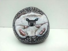 A Hedghog painted on rock, by me..Shelli Bowler :-)