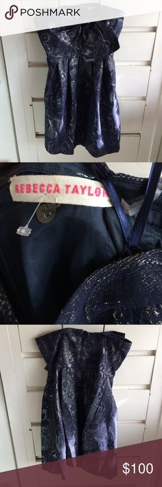 Rebecca Taylor metallic party bow dress size 10! This is a beautiful Rebecca Taylor navy blue and silver strapless metallic party bow dress in size 10. Only worn twice. Taylor Swift wore this same dress in a different color way in 2009. Perfect for the holidays! Enjoy! Rebecca Taylor Dresses Mini