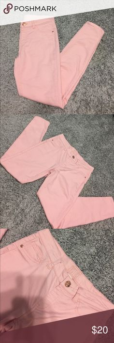 Light pink jeans Very cute light pink jeans with rose gold buttons from Justice! Perfect condition. Worn once. Very comfy, soft & stretchy. Justice Bottoms Jeans