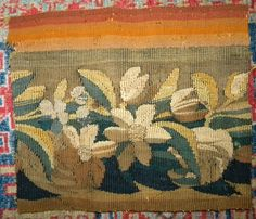 This pretty antique French tapestry fragment is .......