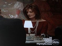 Rene Russo's style in The Thomas Crown Affair