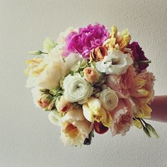 Brightly colored bouquet with peonies, lisanthus, and parrot tulips