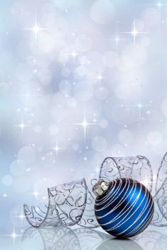 Christmas bauble with curled ribbon on holiday background - Stock Photo ,