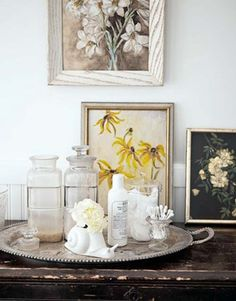 Flea-market paintings, along with vintage apothecary jars corralled on a silver tray, pretty up the guest bath. Old Home Renovation, Old Home Remodel, Farmhouse Renovation, Farmhouse Chic, Home Remodeling Diy, Apothecary Jars, Jar Storage, Storage Ideas, Old Houses