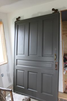 Door painted with Dragon's Breath by Benjamin Moore. One of the best interior door and cabinet colors. Always looks fantastic.