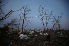 FILE - In this Feb. 8, 2017 file photo, the moon rises over a destroyed neighborhood in the aftermath of a tornado that tore through the New Orleans East section of New Orleans.  Forecasters are warning of severe storms as a powerful system moves across the central United States, the start of what could a turbulent stretch of spring weather over the next few days. The bull's-eye for some of the most fearsome weather _ including possible tornadoes, s over parts of Louisiana, Arkansas and e...