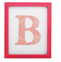 Cover wooden letter with scrapbook paper using mod podge & hang in open back frame!