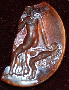 Fragment of an orange-red cornelian intaglio: woman seated on a winged phallus.