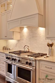 Viking range and marble backsplash
