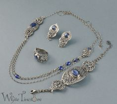 Very time- and work-consuming jewelry set, consisting of necklace, clips, bracelet and ring. All the details, from slender vines, along with twigs, to tiny leaves, were totally hand formed, and the...
