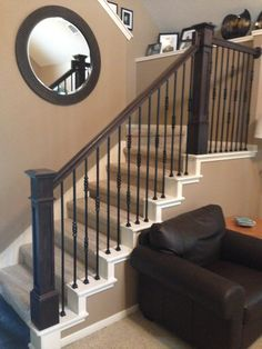 At the Ballesteros residence we removed the old newel posts and installed new box newels.  We replaced the handrail, and installed our powder coated 19/1, 19/2, and 18/3 balusters.  The new stair rail has a rustic modern ascetic that can't be beat.