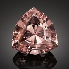 RARE GEMSTONE: PINK FLUORITE - 221 CT.  Gilgit, Pakistan    Pink Fluorite is a relatively uncommon color for this multi-hued  mineral, occurring chiefly in cavities high in the Alps. The last  decade or so has seen similar specimens starting to appear from the  same mountain type environment in Pakistan