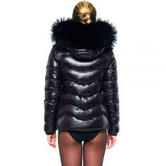 Superwarm black puffer jacket from WeLoveFurs. Made from top quality goose down filling and finished with an oversized finnraccoon fur trim on the hood.