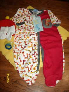 Swaddled Baby Boys Swaddled Red Giraffe Pajama Diaper Cake w/Yellow Blanket Diaper Cake RYG07 , You will receive 1-Micro Fiber Receiving Blanket, 1-Full Body Pajama, 1-Handmade Crochet Beanie,1 Pacifier,1 Pair of Socks & 12 Use-able Diapers.$25.00 free ship