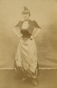 Adolphe Block (France) La Goulue (Louise Weber) in a Moulin Rouge costume Albumen print, Cabinet card, mid 1870s to late 1870s With the photographer's name, location and the Moulin Rouge red mill printed mount recto. NOTE: La Goulue was the French cancan dancer depicted in many of Toulouse-Lautrec's paintings