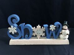Can you tell I love snowmen? - Snow theme table decoration - Plush snowman - Snowman themed door knob decor with bells - Snowman wall decor Enjoy & Happy Snow Days:-) Price includes shipping