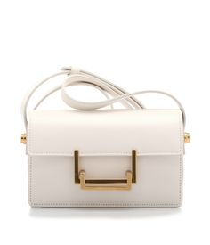Lulu clutch. Leather bag with shoulder strap included.  @Yves Saint Laurent