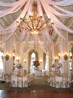 white ceiling drapery treatment with string lights