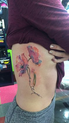 "Watercolor flower tattoo with my dad's handwriting ""So it goes"""