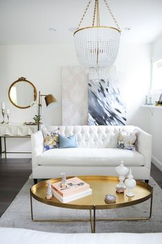 Tufted sofa, art and some vintage elements to make this home beautiful   Chrissy