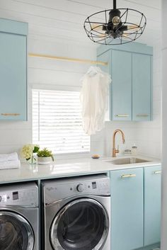 Cool Blue Cabinets - 10 Laundry Room Ideas We're Obsessed With - Southernliving. These aqua cabinets are the stuff of dreams. Paired with the white shiplap walls, the room has a breezy, unfussy vibe. Brass hardware keeps things polished.  See Pin