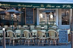 Le Flore en l'Ile,close to notre Dame (ile st. Louis) will have typical French favorites such as escargot, onion soup etc, that the kids will like. Reviews better than tourist trap in Latin Quarter area and would be convenient for a lunch after ND towers without reservations assumedly.