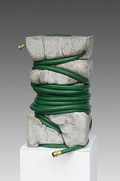 "Jeff Muhs  'The Gardeners Dilemma' -2011  Concrete and garden hose 12"" x 12 "" x 22 "" ."