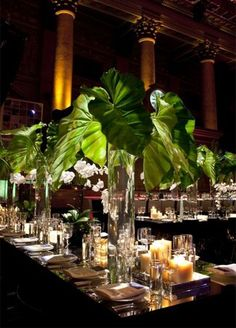 Centerpieces: Fern, elephants ear, and banana leaf- oh my! Larger then life greens make for a show-stopping centerpiece.