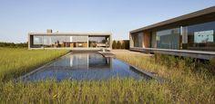 Zero-edge pool, bluestone deck, & native dune grasses in the Hamptons, New York, Designed by Edmund Hollander Landscape Architect