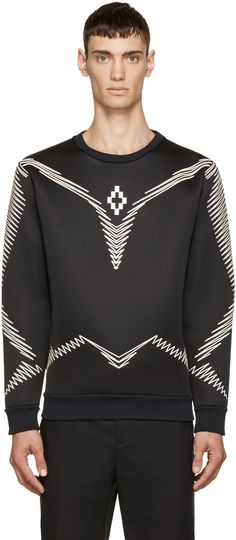 Long sleeve neoprene sweatshirt in black. Ribbed knit crewneck collar, cuffs, and hem. Raised rubberized prints throughout in white. Velvet interior. Tonal stitching.
