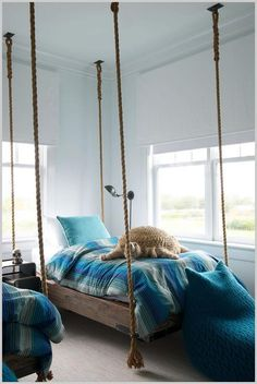 SSS Design & Interiors - Shared boys' bedroom is furnished with two twin wood and rope hanging beds accented with blue striped bedding topped with aqua blue velvet pillows. Striped Bedding, Blue Bedding, Blue Bedroom, Suspended Bed, Interior Exterior, Interior Design, Hanging Beds, Hanging Chairs, Boys Room Design