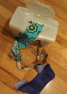 101 Toddler Activities.  The one above is genius.  I hate finding wet wipes out when I left the room for 2 seconds.