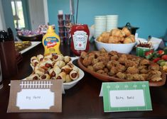 """Pigs in a Blanket """"Pig Skins"""" and sausage balls """"blitz balls"""" Football birthday party food ideas - perfect Super Bowl Party Food and tailgate food ideas for a football watching party! Fear the Spear - Football Birthday Party Ideas, Food, Decor and Activities Football Favors, Football Party Foods, Football Birthday, Chocolate Covered Pretzel Sticks, Sausage Balls, Tailgate Food, Ketchup, Birthday Parties, Pigs"""