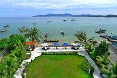 Garden and beach views from Beachfront Luxury Condo in Phuket, Thailand