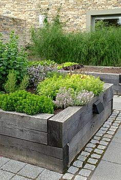 A Spring Garden With DIY Raised Garden Beds I like the stones and raised garden bed. Great for a vegetable or herb garden.I like the stones and raised garden bed. Great for a vegetable or herb garden. Back Gardens, Outdoor Gardens, Courtyard Gardens, Modern Gardens, Veg Garden, Vegetable Gardening, Garden Planters, Vegetable Planters, Vegetable Boxes
