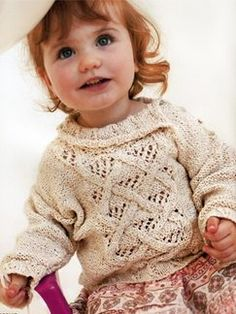 Love the neat lace and cables on this sweater.