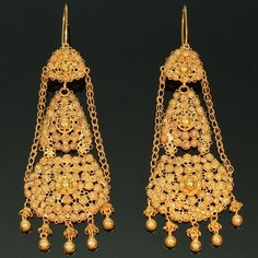 14K gold and garnet drop earrings, 2.5 inches in length; circa ...